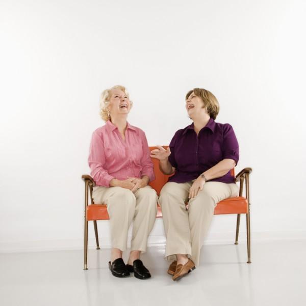Women sitting laughing.