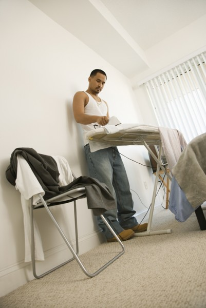 Young Man Ironing