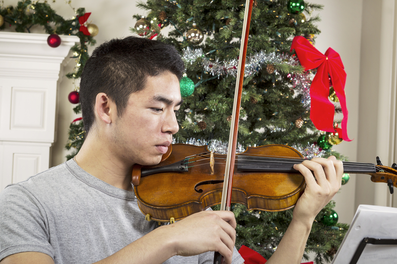 Young Adult Man Playing Music During the Holidays