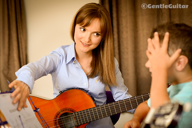 Benefits of Guitar Lessons for Children + GIVEAWAY - Redhead Mom